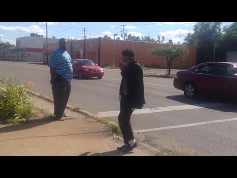 Michael Jackson impersonator moonwalk across Flint street in front of traffic