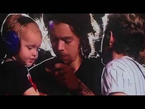 Harry Styles holding a child at the Nashville Concert 8/19/14