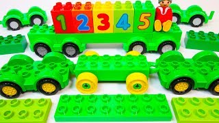 Learn Colors + Numbers 1-5 with GREEN Duplo Cars and Trucks - A Building Blocks Toys Video