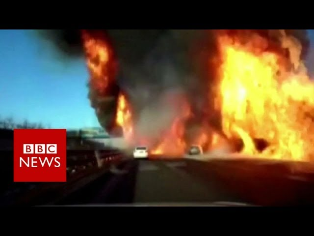 Flames engulf highway in China after gas tanker overturns - BBC News