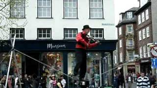 Rope walker playing violin