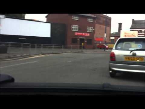 [Driver turns into oncoming traffic by mistake.] Video
