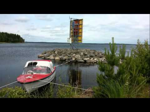 Classic motorboat Kitty Can travelling in North Carelia lake Saimaa summer 2014