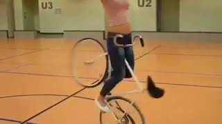 Impressive pretty girl doing amazing bike tricks
