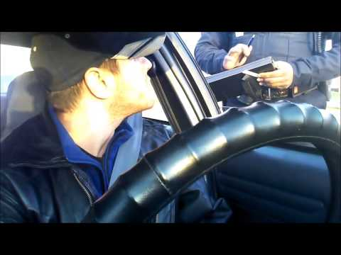 Brady Lake Ohio Police Brutality, wrongful arrest, and assaulted over front license plate