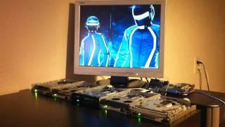 Canción de Tron: Legacy interpretada con 5 disqueteras