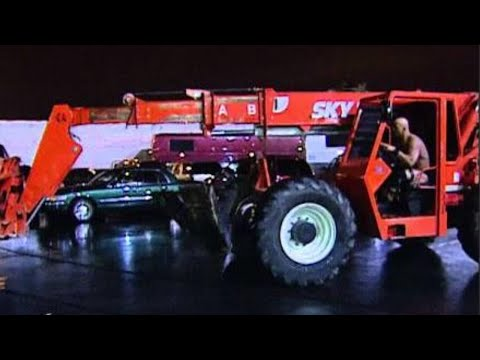 """""""Stone Cold"""" Steve Austin traps Triple H in his car and drops him high above using a forklift: Survi"""