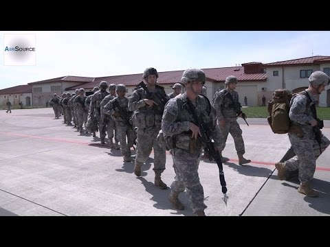 US Sends Troops to Eastern Europe. Soldiers Load into C-130.