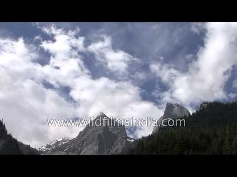 Clouds passing over Himalayan mountains en route Lamkhaga Pass in Himachal Pradesh