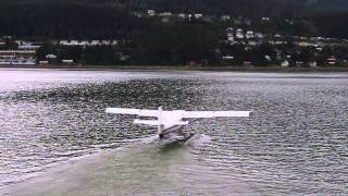 Juneau Alaska Sea Plane taking off from downtown around the Ships.