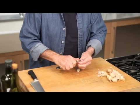 Jacques Pépin masterfully chopping garlic -