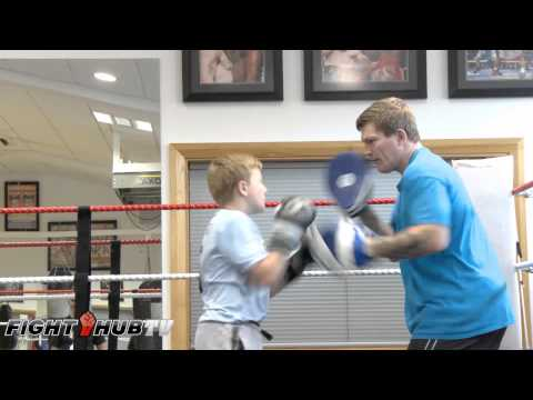 Ricky Hatton's son, shows off body punch combinations as he works the mitts with dad