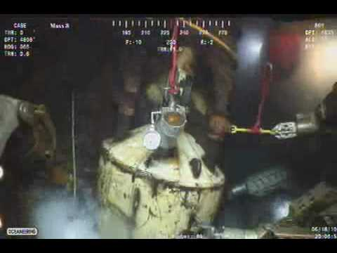 BP Oil Spill - Clear view of top of cap while ROV adjusts vent