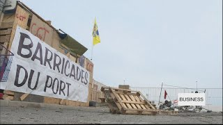 French unions blockade ports as strikes drag on