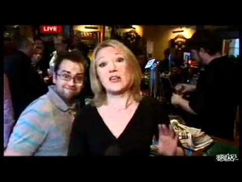 Drunk Dude Video Bombs Reporter In Bar