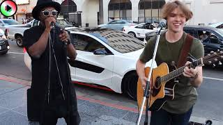 Will.i.am - Star mondiale canta insieme ad artista di strada - surprises street performer
