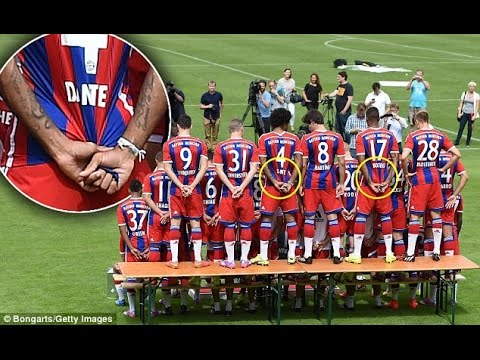 Bayern Munich stars Dante and Jerome Boateng appear to pull shirts tight during team photo..
