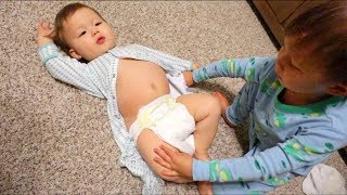 Toddler Changes Baby's Diaper! (Super Fail!)