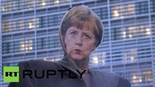 Belgium: Protesters burn Merkel effigy to stop TTIP and TAFTA Image