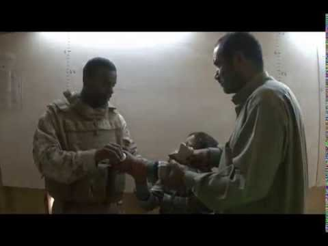 Marines of 1/4 Charlie Medical Aid to Iraqi Boy Fallujah 2008