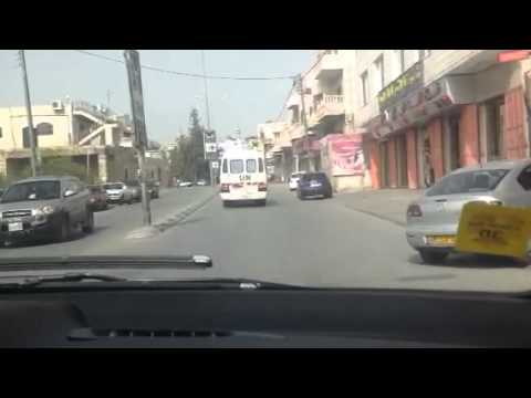 Pastor Begley Driving Behind UN Bus In Bethlehem