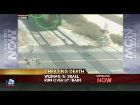 Woman Survives from Train Video