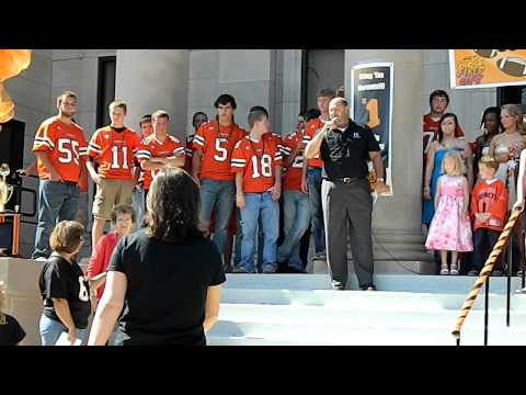 Chamber President David Owens announces the winners of the Paint the Town Orange Decorating Contest at the HHS Homecoming Parade Pep Assembly on the steps of...