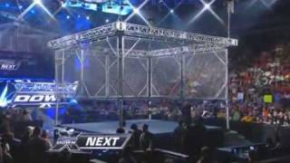 WWE SmackDown 1/23/10 Batista vs Rey Mysterio - Steel Cage Match Part 1/2 HQ