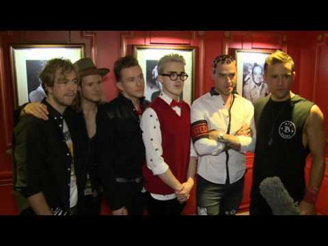 McBusted: Dougie Poynter plays air guitar and Harry Judd grabs a reporter!