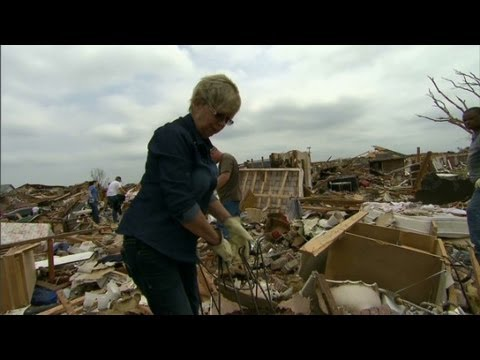 Tornado survivor looks for memories
