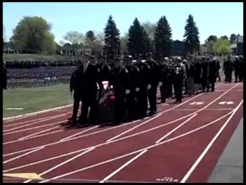 Chief Maloney's coffin is carried around the Winnacunnet High School track