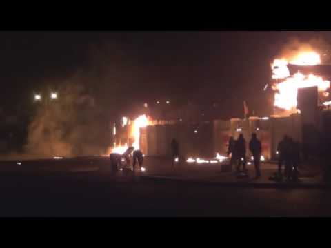 bahrain burning a police station after killing a protester