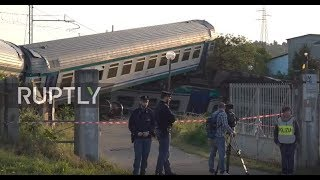 Italy: Police guard wreckage after train collides with truck, killing two