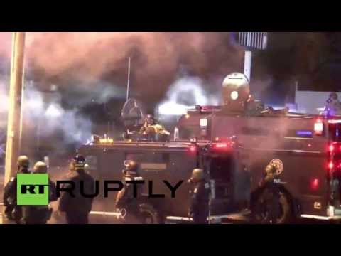 Tear gas, smoke grenades deployed as Ferguson protesters defy curfew