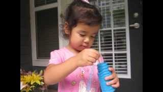 Mili blowing bubbles