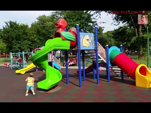 Outdoor playground for children.  Slides, carousel and fun in the park.  Video 2015