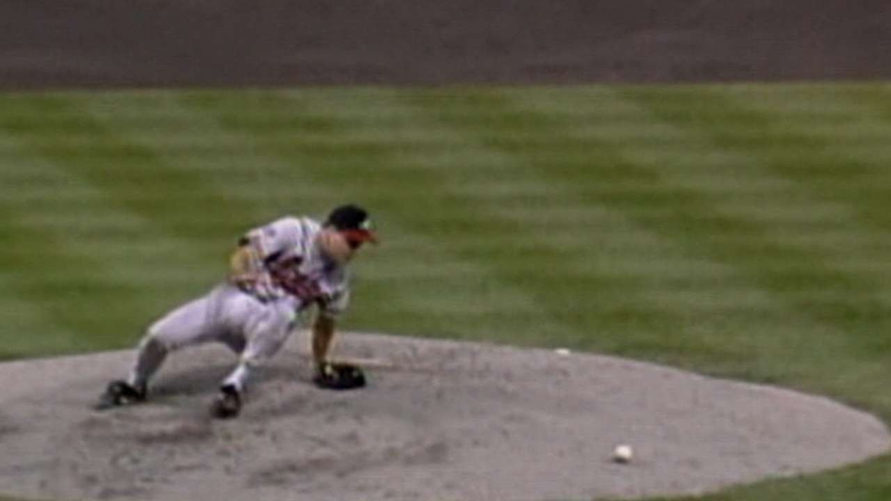 Maddux falls down, recovers to get the out