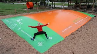 GIANT SLIPPERY TRAMPOLINE IN THE RAIN!