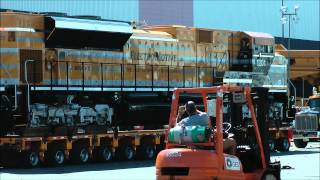 Caterpillar Electro - motive train being moved by road