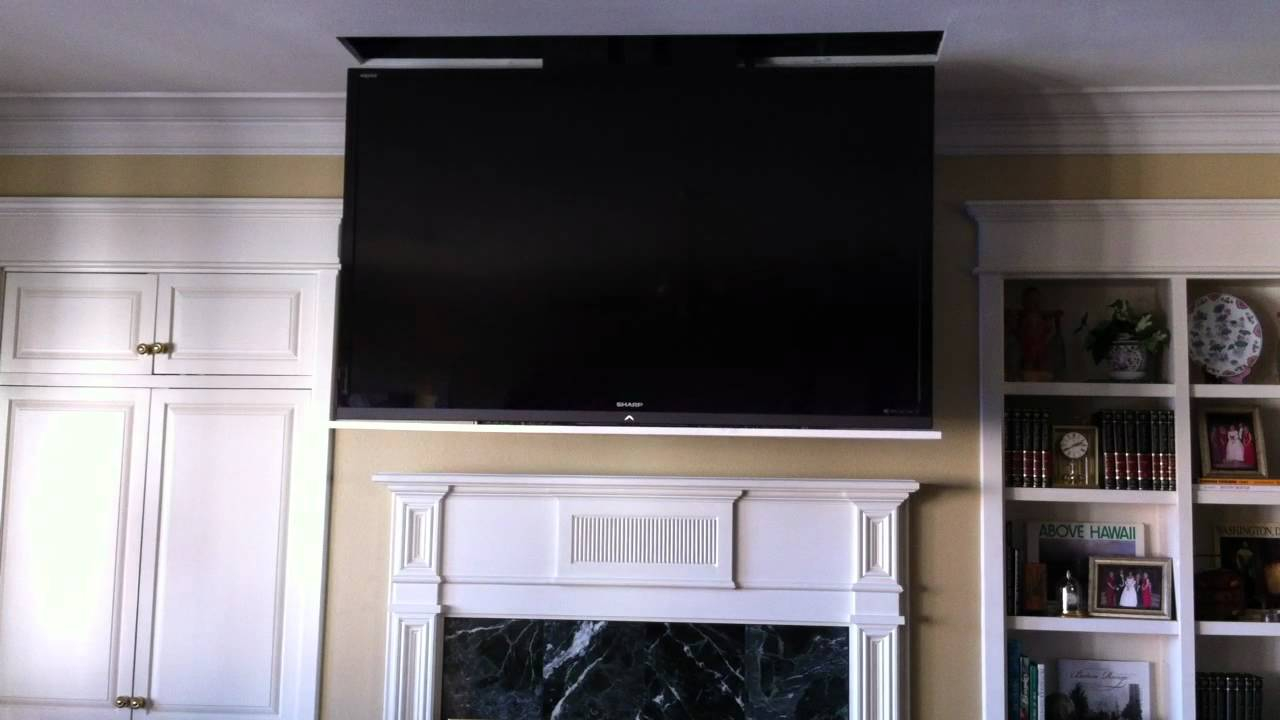 Motorized 70 led flat panel tv disappears into ceiling for Motorized ceiling tv mount