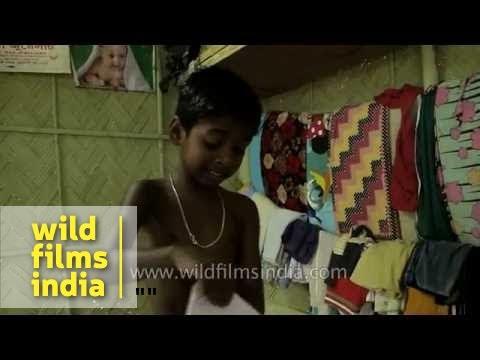 Mother helps son to dress up school uniform, Assam
