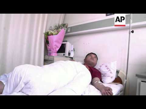 Police officer who was stabbed in Kunming attack speaks from hospital bed
