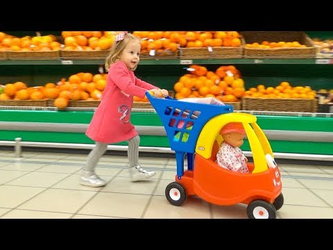 Funny Kid and Baby Doll Lola doing shopping at the Supermarket