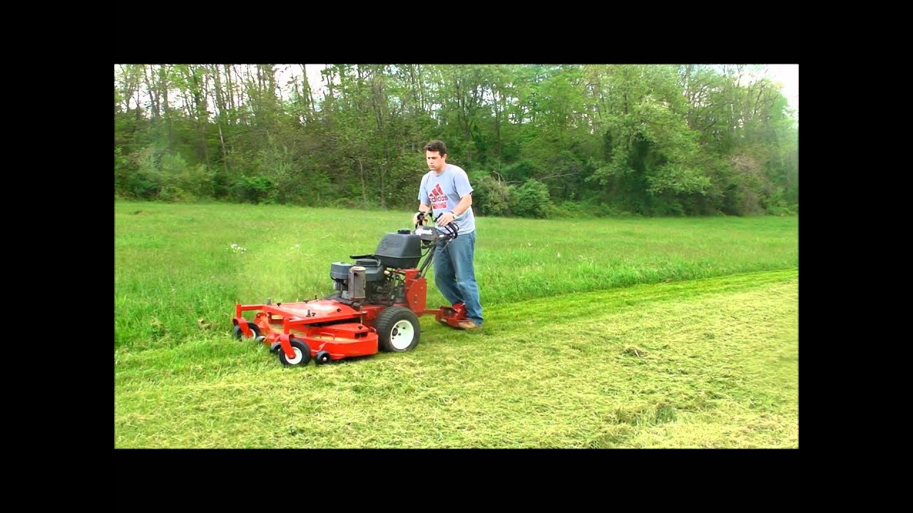 Exmark 48 Turf Tracer HP w/stand on sulky... - YouTube