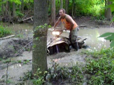 Polaris Scrambler 4x4 2 Stroke Takes on Deep Mud Hole