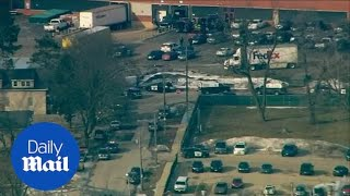 Gunman who opened fire at Illinois warehouse is apprehended