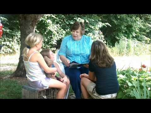 Myra Brown Reading to her grandaughters in her garden outside- Everett Green, A Tree for All Seasons