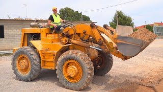 The Tractor loader broken down Funny Dima Ride on POWER WHEEL Tractor to help man