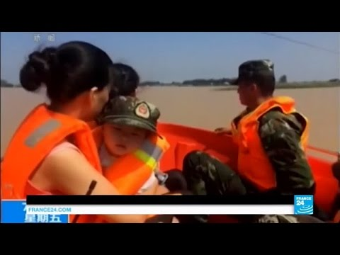 China floods: four officials suspended as death toll hits 114