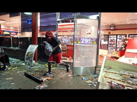 Riots erupts after black teen shot by police in Ferguson, Missouri